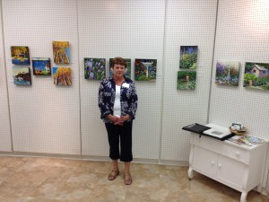 Madeleine Bellmond with her art at the Centre d'Arts Visuels de l'Alberta